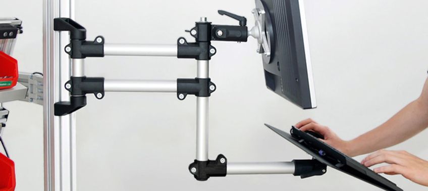 The adjustable support arm for the monitor mounting can be combined with a keyboard tray